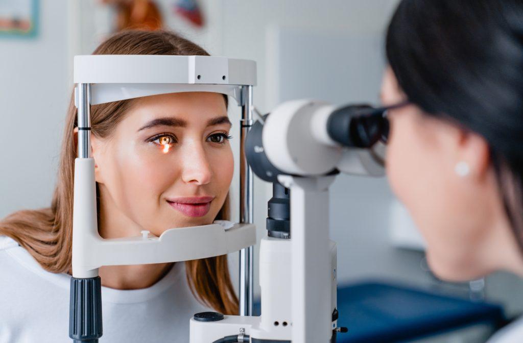 Adult woman getting her regular eye exam from her optometrist