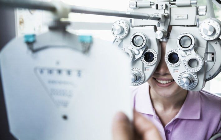 A woman at the optometrist getting her vision examined